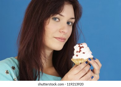 portrait of a young pretty girl with cake