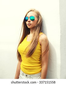 Portrait young pretty girl wearing a sunglasses and t-shirt in city