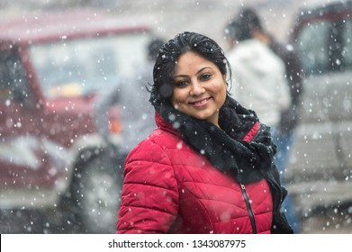 Portrait of a young pretty lady / woman in red jacket at a himalayan city in India