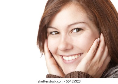 Portrait of young, pretty smiling woman with hands on face. Isolated on white background.
