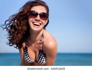 Portrait of young pretty woman having good time on sea