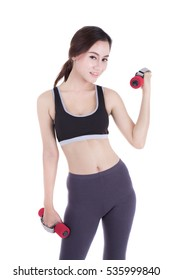 portrait of a young pretty woman holding weights and doing fitness against a white background. asia