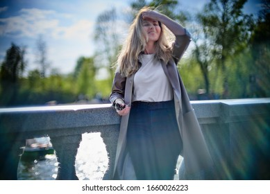 Portrait of a young pretty woman outdoors in warm spring weather