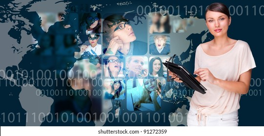Portrait of young pretty woman working on modern tablet computer while standing against big virtual map with photo of her friends or colleagues