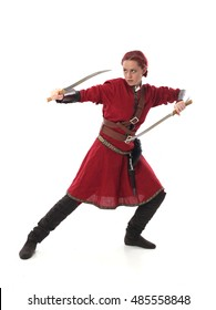 portrait of a young, red haired  female warrior,  wearing a red medieval tunic and leather Armour.  isolated on a white background holding  a weapon.