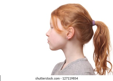 Portrait of a young red haired girl with ponytail on white background