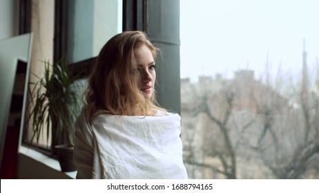 Portrait Of Young Red-Haired Girl By The Window.