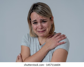 Portrait of young sad depressed woman crying, looking miserable and hopeless. Feeling sorrow, grief and fear. In People, mental health, broken heart, facial expressions and emotions concept.