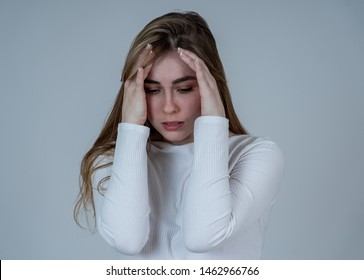 Portrait of young sad teenager girl feeling lonely and distressed suffering from depression looking hopeless and suicidal. Feeling sorrow and fear. In People, emotions and adolescent mental health.