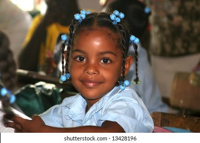 Portrait of a young schoolgirl sitting  in the classroom