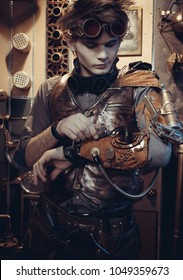 Portrait of a young scientist in the steampunk style in his laboratory.