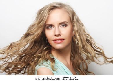 Portrait of young sensual blond woman. Studio shot.