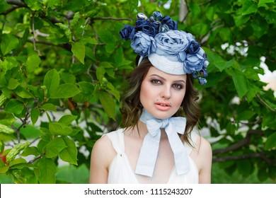 portrait of young sensual woman posing in elegant headwear