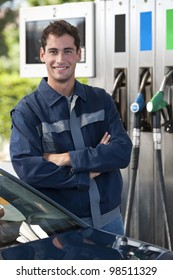 Portrait of a young service station worker smiling at camera