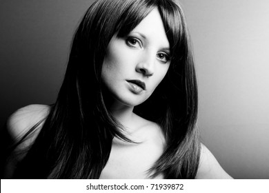 Portrait of the young sexual woman closeup. The Black-and-white photo