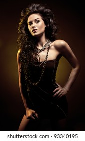 Portrait of young sexy beautiful woman with long black hair on dark background