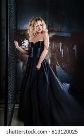 portrait of young sexy blonde woman in a black dress