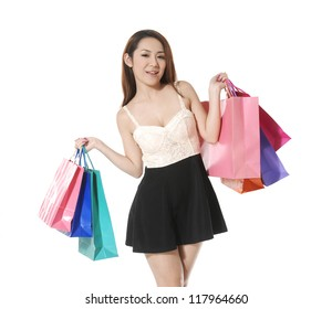 Portrait of young sexy girl with shopping colorful bag