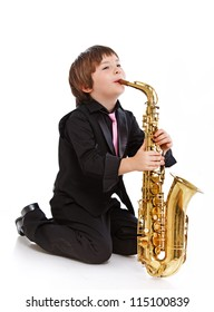 Portrait of young sexy musician posing in studio with saxophone