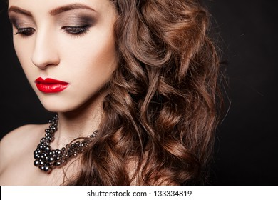 portrait of young sexy woman with necklace