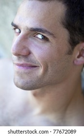 Portrait of a young shirtless man
