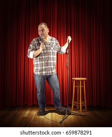 Portrait of a young showman or stand-up comic with the microphone. Show concept.
