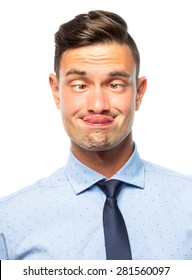 Portrait of a young silly businessman with funny face, isolated on white background