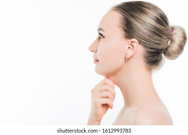 Portrait of a young slender girl pulling her second chin with her hand.