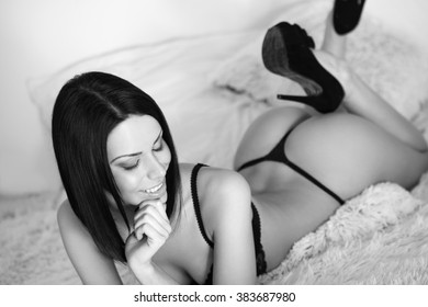 Portrait of a young slender sensual brunette woman in lingerie.