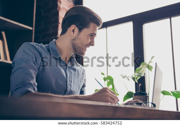 Portrait of young smart happy student preparing for the exams