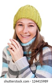 Portrait of young smiley girl wearing a colorful sweater on isolated white background