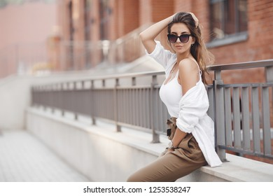 Portrait Of Young Smiling Beautiful Woman. Close-up portrait of a fresh and beautiful young fashion model posing outdoor. Summer outdoor photo