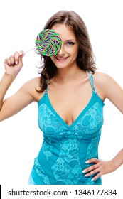 Portrait of young smiling beautiful woman with dark hair in blue dress with lolipop candy, isolated on white background.