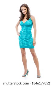 Portrait of young smiling beautiful woman with dark hair in blue dress in full growth, isolated on white background.