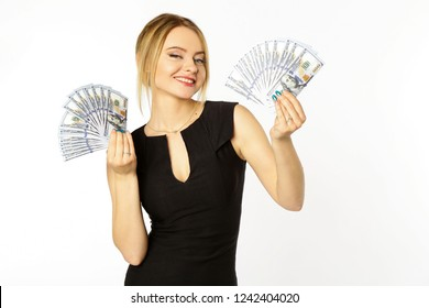 Portrait of a young smiling blonde girl with money dollars in hands isolated white background.