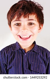 portrait of young smiling boy with big head