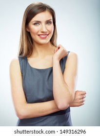Portrait of young smiling business woman white background isolated. Female model corporate business dressed.