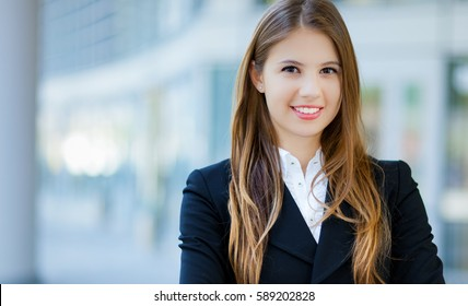 Portrait of a young smiling business woman outdoor