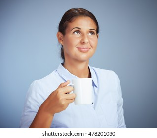 Portrait Of A Young Smiling Businesswoman Having A Coffee Break