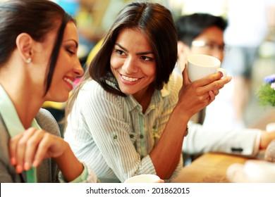Portrait of young smiling businesswomen having coffee break