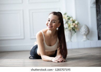 Portrait of a young smiling woman after workout at home. Beautiful healthy girl.