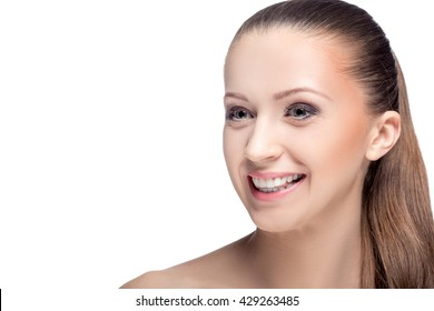 portrait of young smiling woman with brown eyes isolated on a white background. everyday makeup