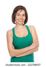 Portrait of a young smiling woman looking relaxed, confident, with her arms crossed, isolated on white