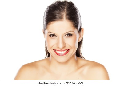 portrait of a young  smiling woman on a white background