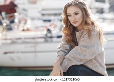 Portrait of a young smiling woman outdoor. Happy face. Summer girl in the city
