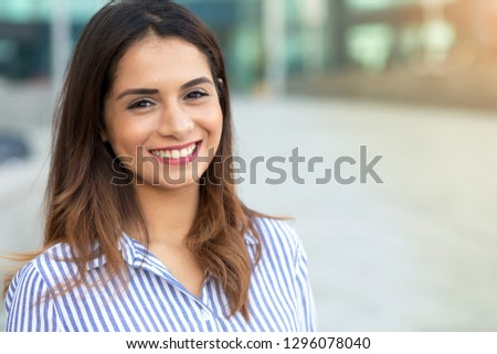 Portrait of young smiling woman outdoor with sunligth flare and copy space 2db33fab4a646