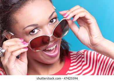 Portrait of a young smiling woman wearing sunglasses