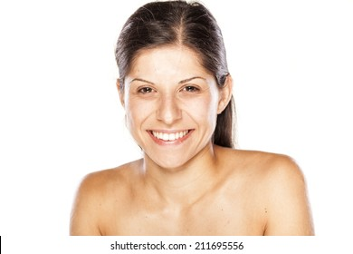 portrait of a young  smiling woman without make up on a white background