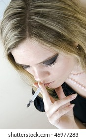 Portrait of a young smoking woman