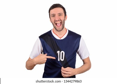 Portrait of young soccer player pointing to number 10 on t-shirt. Sport concept.